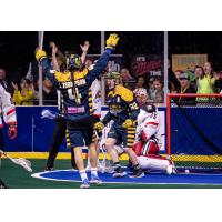 Shayne Jackson (center) and Lyle Thompson celebrate a Georgia Swarm goal