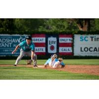 Tyler Finke of the St. Cloud Rox slides safely into second against the Rochester Honkers