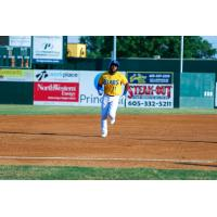 Jabari Henry of the Sioux Falls Canaries rounds the bases following his home run