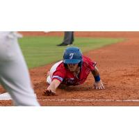 Hueston Morrill of the Tulsa Drillers slides safely back into first base during Wednesday's action at ONEOK Field