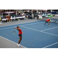 Venus Williams serving in mixed doubles action for the Washington Kastles