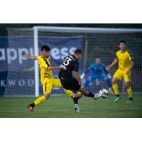 Aidan Daniels of Colorado Springs Switchbacks FC unleashes a shot against New Mexico United