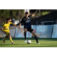 Colorado Springs Switchbacks FC right back Jordan Burt with possession against New Mexico United