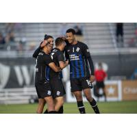 Colorado Springs Switchbacks FC celebrate an Aidan Daniels goal against New Mexico United