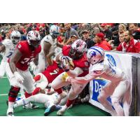 Jacksonville Sharks linebacker/fullback Zack Brown carries the ball against the Columbus Lions