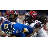 Defensive back Michael Knight with the Washington Valor makes a tackle against the Tampa Bay Storm