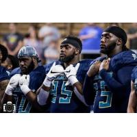 Massachusetts Pirates defensive lineman Willie Yarbary (middle)