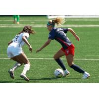 Washington Spirit defender Natalie Jacobs (right)