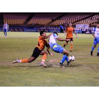 Las Vegas Lights FC midfielder Javan Torre is dragged down in the box by OCSC's Ronald Alexis Cerritos