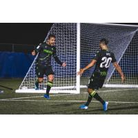 York9 FC striker Alvaro Rivero (left) celebrates with teammate Diyaeddine Abzi