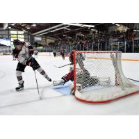 Aberdeen Wings take a shot against the Fairbanks Ice Dogs