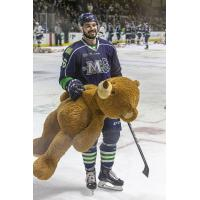 Morgan Adams-Moisan of the Maine Mariners helps remove bears from the ice after the Teddy Bear Toss