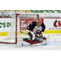 Prince George Cougars goaltender Tyler Brennan makes a stop against the Vancouver Giants