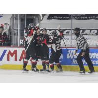 Prince George Cougars react after a goal vs. the Vancouver Giants