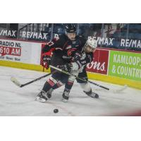 Riley Heidt of the Prince George Cougars delivers a blow vs. the Vancouver Giants