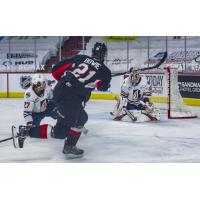 Connor Bowie of the Prince George Cougars takes a shot vs. the Kamloops Blazers
