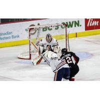 Prince George Cougars centre Craig Armstrong shoots vs. the Kamloops Blazers