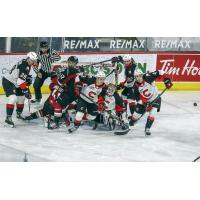 Prince George Cougars clear the puck after a scrum in front of their net vs. the Vancouver Giants