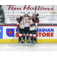 Prince George Cougars congratulate Koehn Ziemmer on his goal vs. the Vancouver Giants