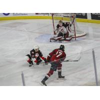 Prince George Cougars goaltender Taylor Gauthier stops the Vancouver Giants