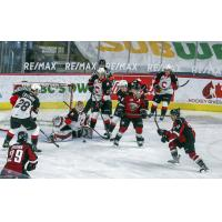 Vancouver Giants centre Tristen Nielsen (right) takes a shot vs. the Prince George Cougars