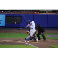 Jake Hager of the Syracuse Mets connects with a ball in the bottom of the fifth inning for a grand slam