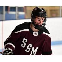William Whitelaw with the Shattuck St. Mary Prep Team