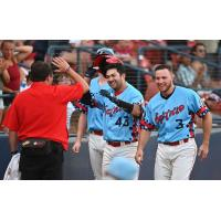 Spokane Indians catcher Daniel Cope (43) is congratulated by Kyle Datres (3) and others after a home run